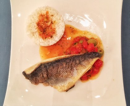 Sea bream with tomato and olive vinaigrette sauce