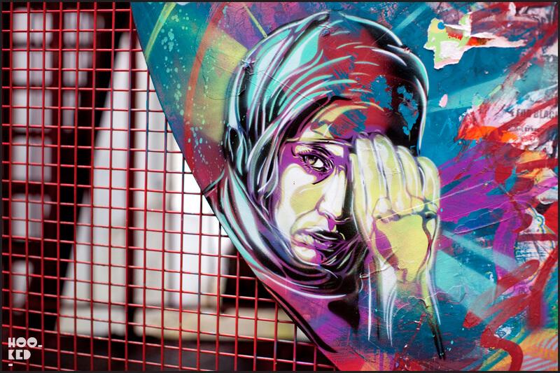 London street art portrait of a women in a headscarf by artist C215