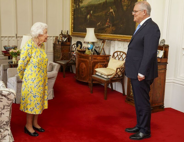 Queen Elizabeth wore a yellow and blue floral dress from  Stewart Parvin. The Queen opted to wear her Jardine Star Brooch