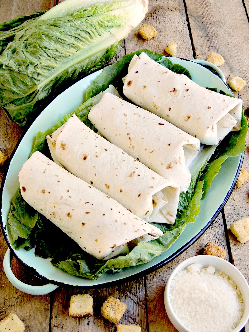Chicken Caesar Salad Wraps are a quick and easy way to enjoy your favorite salad with no fork needed. From www.bobbiskozykitchen.com