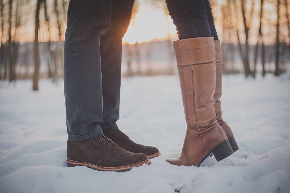 couple-in-boots doing foot exercises to energize tired feet