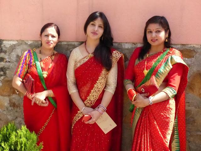 Nepalese women wearing festive red saris