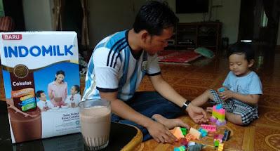 Indomilk susu bubuk rasa coklat untuk anak