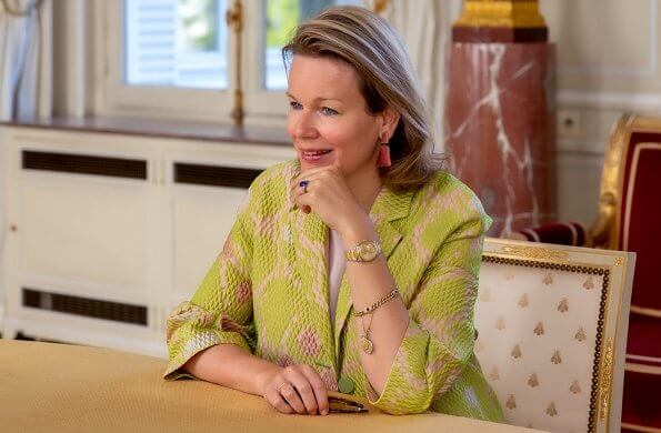 Queen Mathilde wore Emporio Armani green floral print coat. The Maison d'Enfants Reine Marie-Henriette or La Flèche
