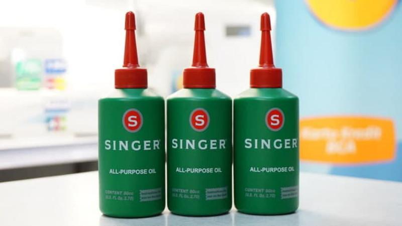 gambar botol minyak singer untuk rantai motor