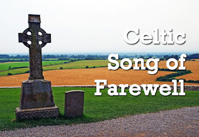 Celtic cross in a graveyard at the top of a hill