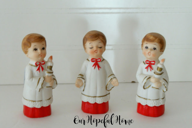 Vintage porcelain choir boys in robes with candles made in Japan.