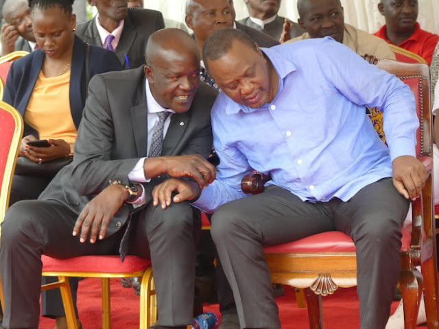 Lands CAS Gideon Mung'aro issuing title deeds with President Uhuru Kenyatta in Nyandarua. PHOTO | BMS