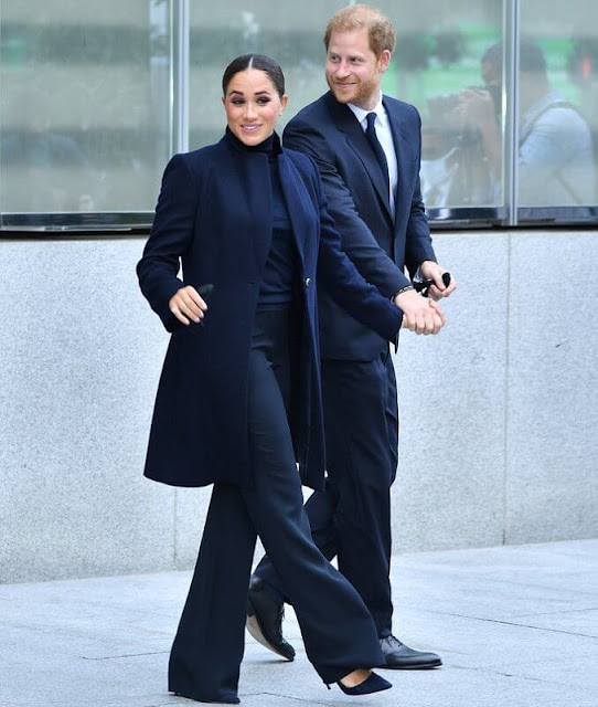 Meghan Markle wore a high-neck sweater with trousers underneath a long coat