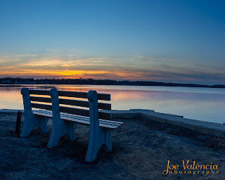 Park bench facing a river at Sunset - Belmar, New Jersey