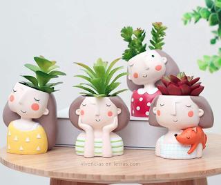 maceteros de cerámica con caras