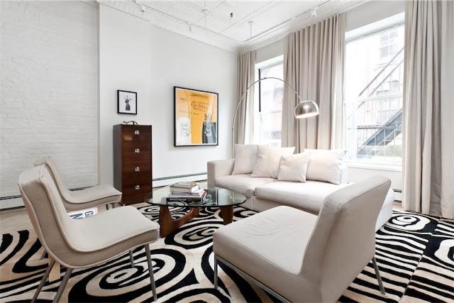 alfombra con detalles geometricos en blanco y negro chicanddeco