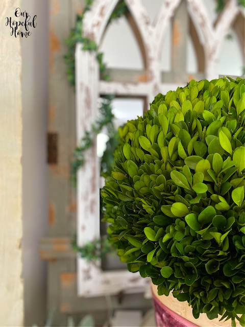 boxwood ball cathedral arch wrapped faux greenery