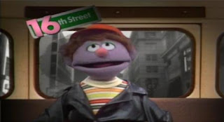 Forty Blocks from My Home is sung by the muppet Farley. Sesame Street Elmo's Travel Songs and Games