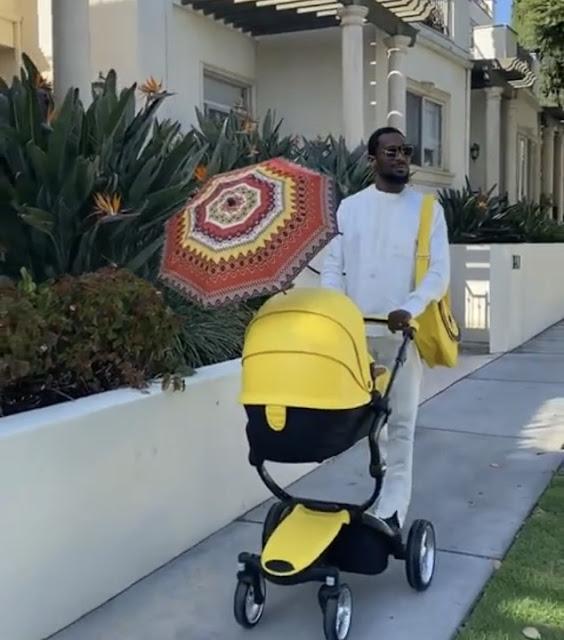 D'banj enjoys a stroll with his newborn baby