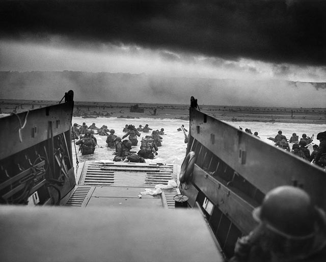 US Army 1st Division soldiers landing at Omaha Beach, 6 June 1944 worldwartwo.filminspector.com
