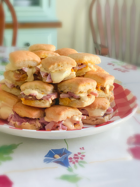 Baked Ham and Angel Biscuits Sliders, a salty cured smoked ham sandwiched between a fluffy buttermilk biscuit.  These are a perfect appetizer to serve at parties.