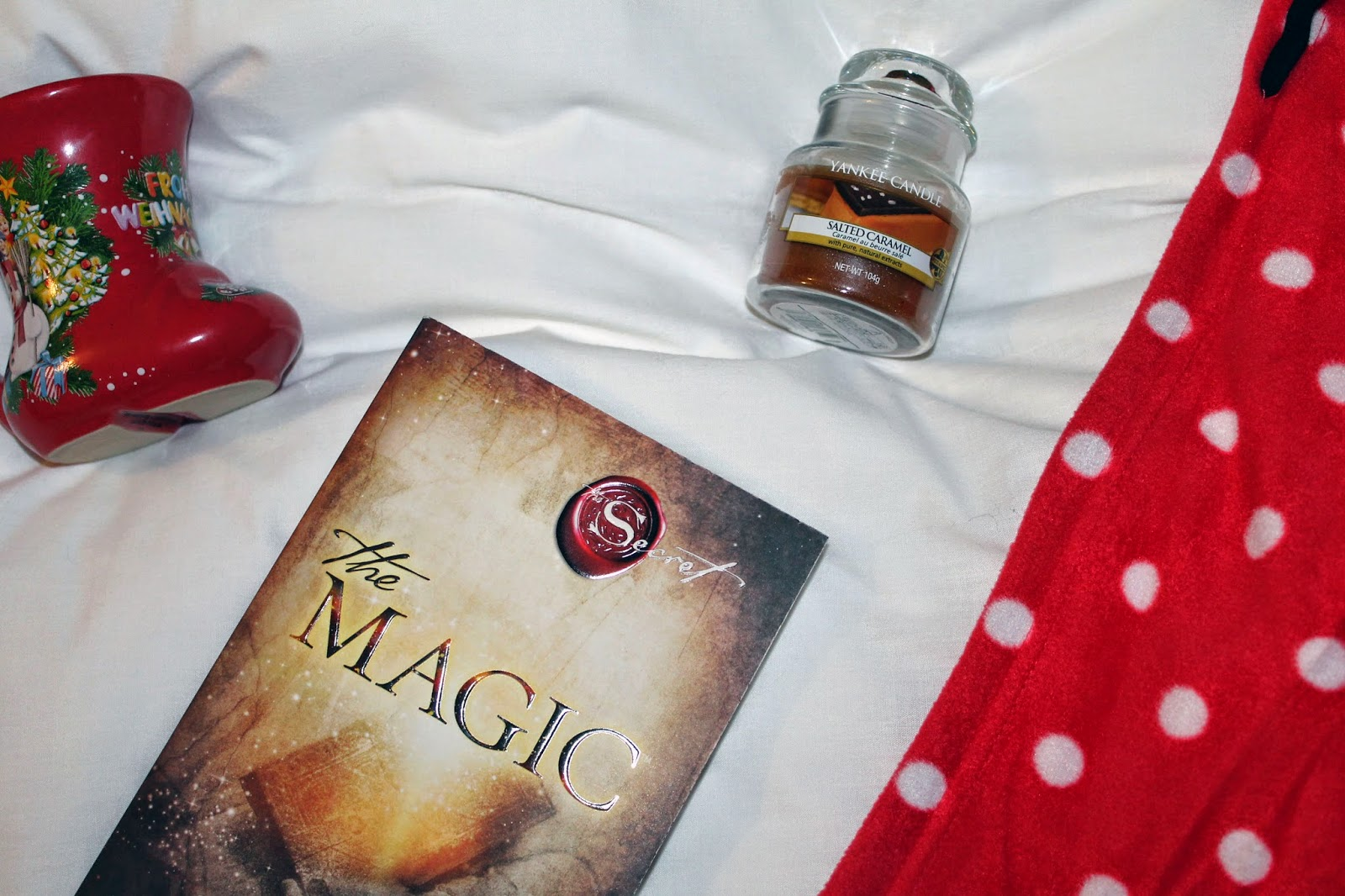winter night in essentails: tea, book, yankee candle and polka dot onesie