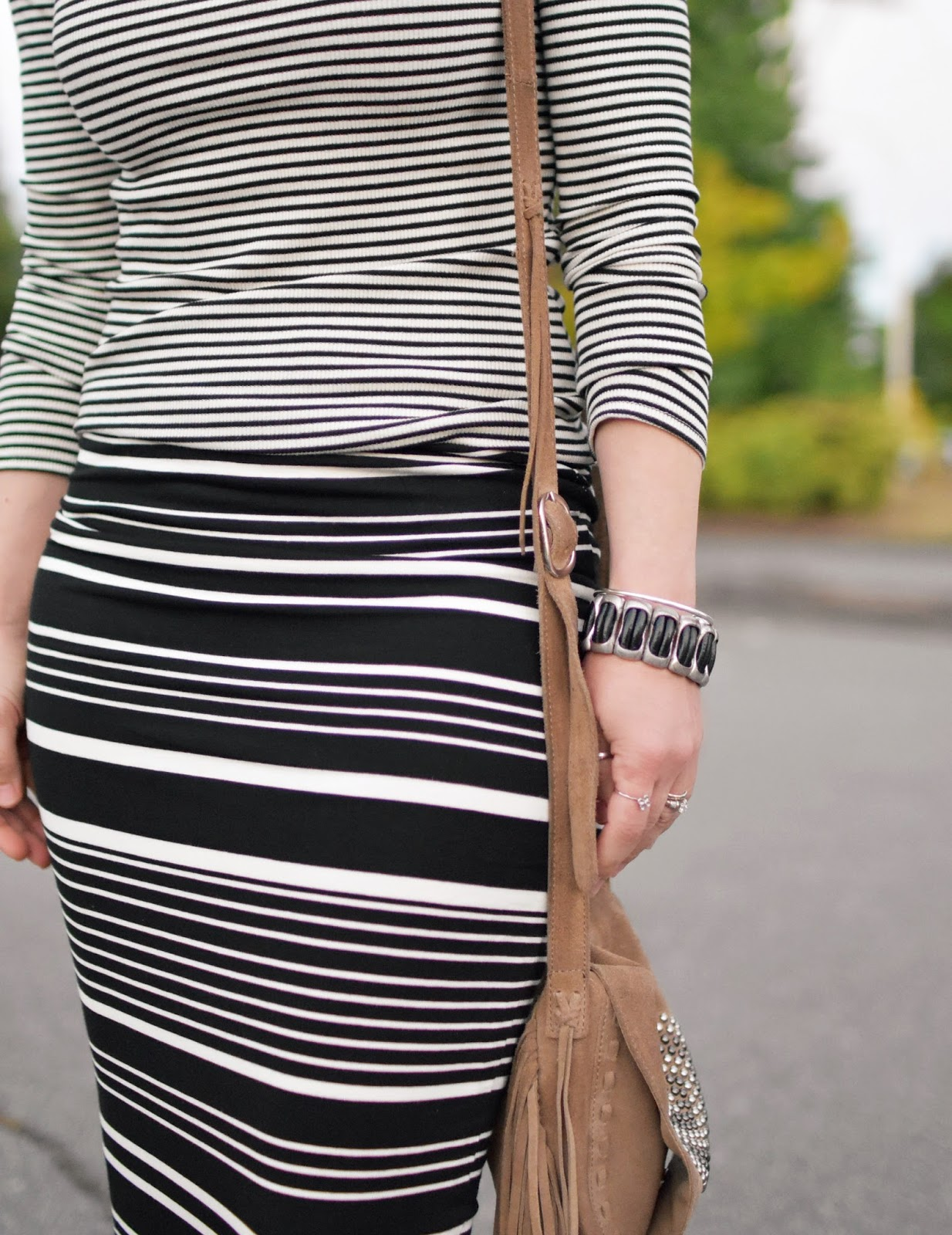 striped midi pencil skirt, striped off-the-shoulder top, fringy cross-body bag