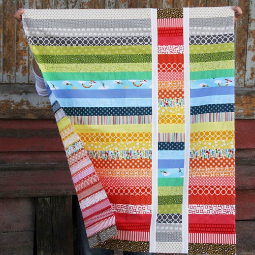 Strip and Flip Baby Quilt designed by Allison Harris of CluckCluckSew