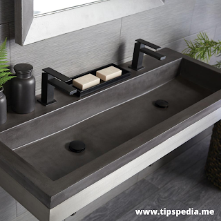 rectangular bathroom sink with two faucets