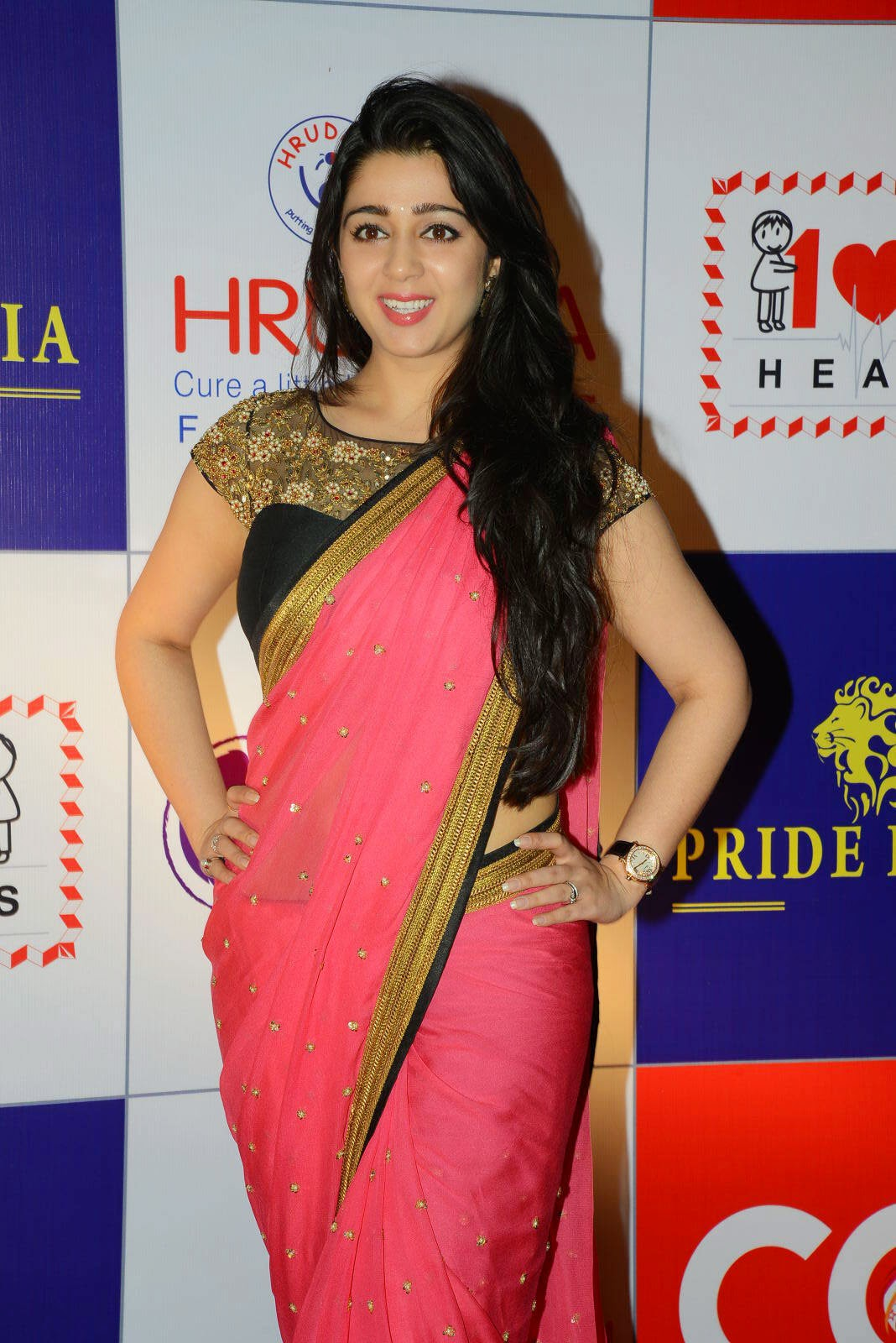 Actress Charmy Kaur Latest Cute Hot Pink Saree Navel Show Spicy Photos Gallery At CCL Charity Dinner