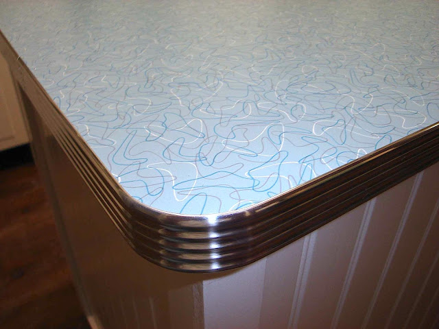 A photo of a 1950s kitchen counter with formica and stainless steel