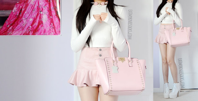 A pastel pink outfit featuring the pink Rockstar leather bag from BagInc, a ribbed thumbhole white crop top from Tobi, a Liz Lisa-style button-front suede skort, a clear Milkstud studded rose choker, and white spiked Jeffrey Campbell Lita dupe platform booties.