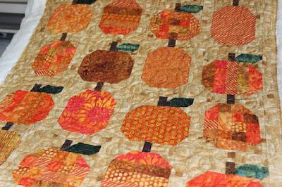 rows of different pumpkin quilt blocks