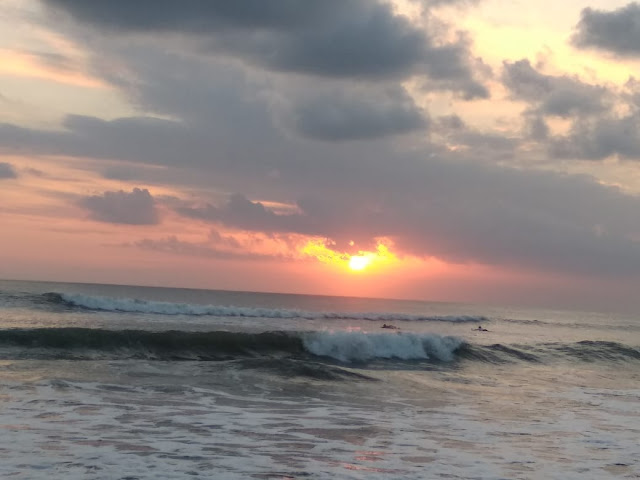 Wave on the Kuta beach combine with cloudy sunset, not too dangerous for beginner surfer