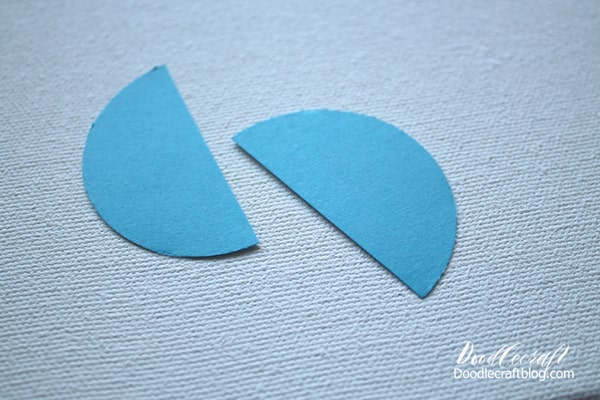 How to make Mermaid fish scales wall art with paper circles in various shades of blue.