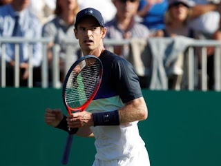 Murray beats Wawrinka to claim first win since return