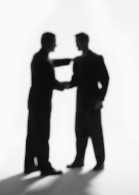businessmen silhouettes shaking hands