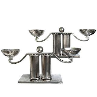 https://www.makassargallery.com/lighting/candlesticks-candelabras/jean-despres-silver-plated-candlesticks