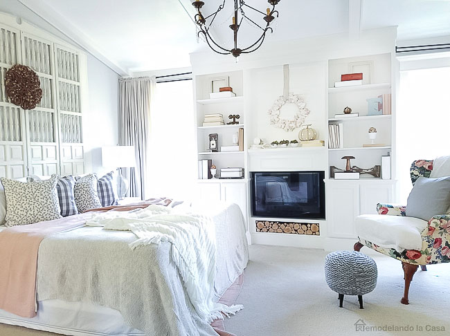 plaid pillows, build-ins, upholstered stool, screen headboard, white on white bedroom decor