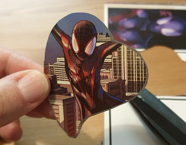 Cut out heart shaped marvel images to make the perfect valentines mobile