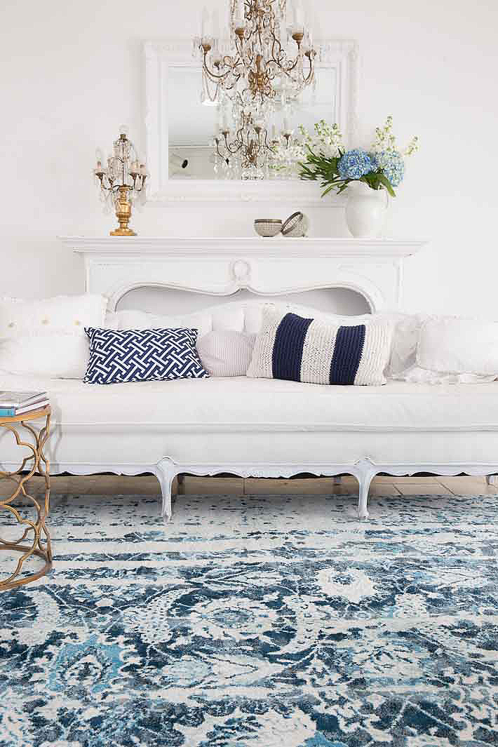 modern vintage living room in navy and white