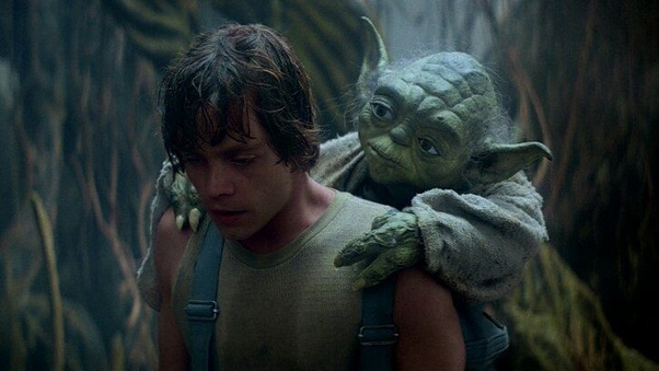 Luke with Yoda strapped onto his back while in Jedi training on Dagobah