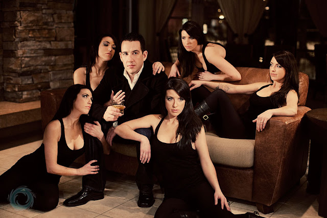 A man with several women around him