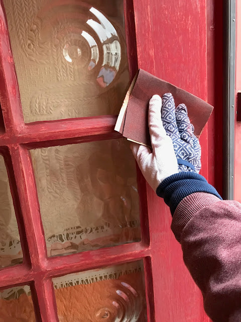 sanding a front door