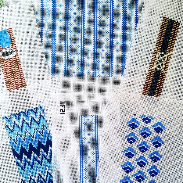 Blue and white needlepoint canvases handpainted zigzag and repeat patterns
