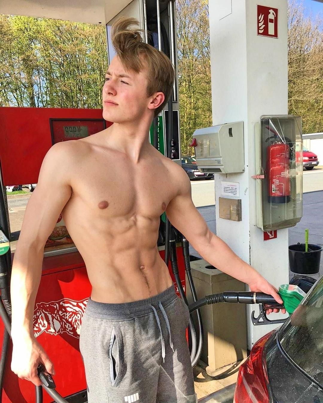 hot-young-college-boy-working-gas-station-filling-cars-shirtless-sixpack-abs-blond-bro
