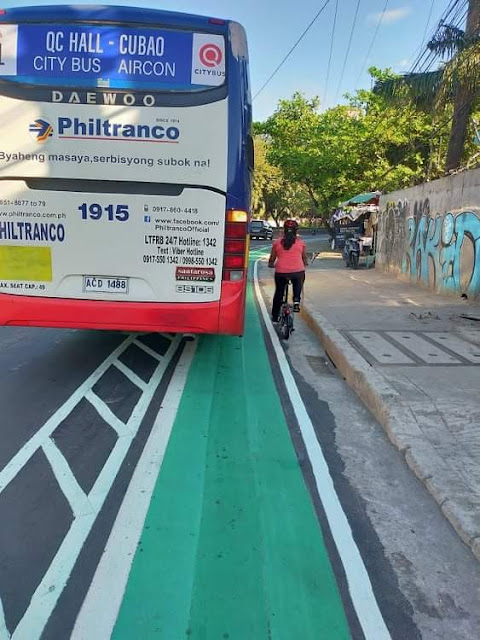 Bus occupying the bike lane - at Kalayaan Avenue, QC