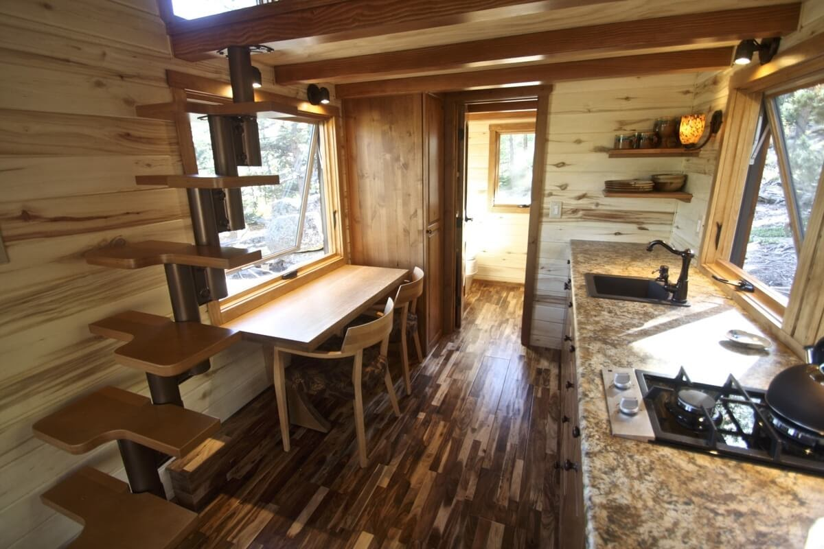 09-Kitchen-and-Dining-Area-Simblissity-Tiny-House-Stone-Cottage-on-Wheels-www-designstack-co