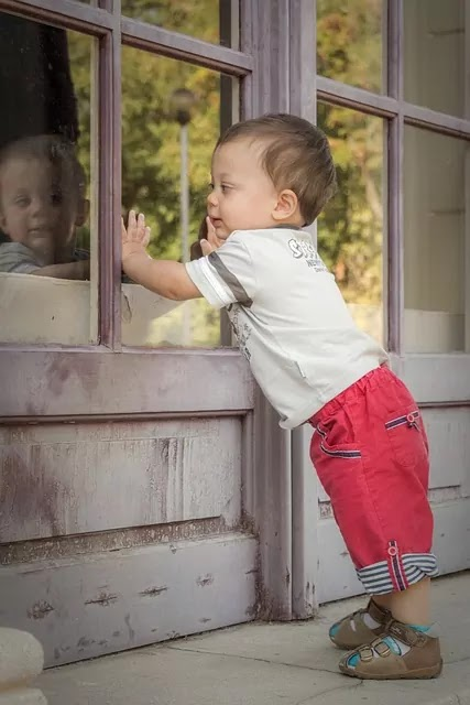 cute baby stand with red pant