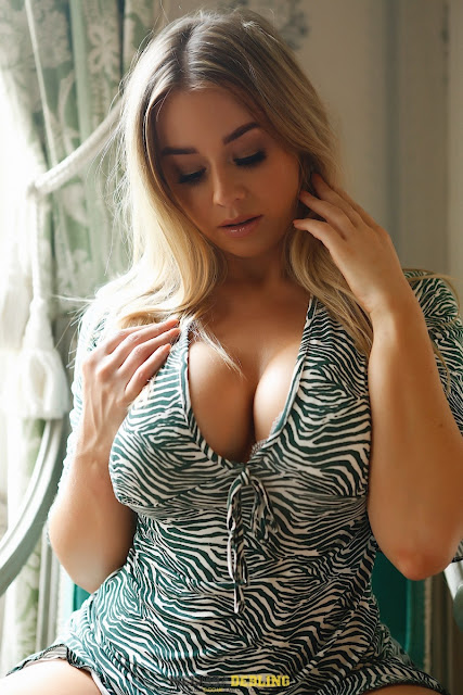 Melissa Debling looking at lovely big boobs sexy