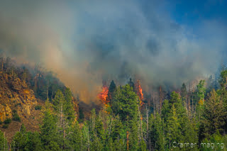 Cramer Imaging's landscape photograph of a two wildfire flare ups near Panguitch Lake Utah