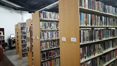 library book shelving in the temporary location at 25 Kenwood Circle