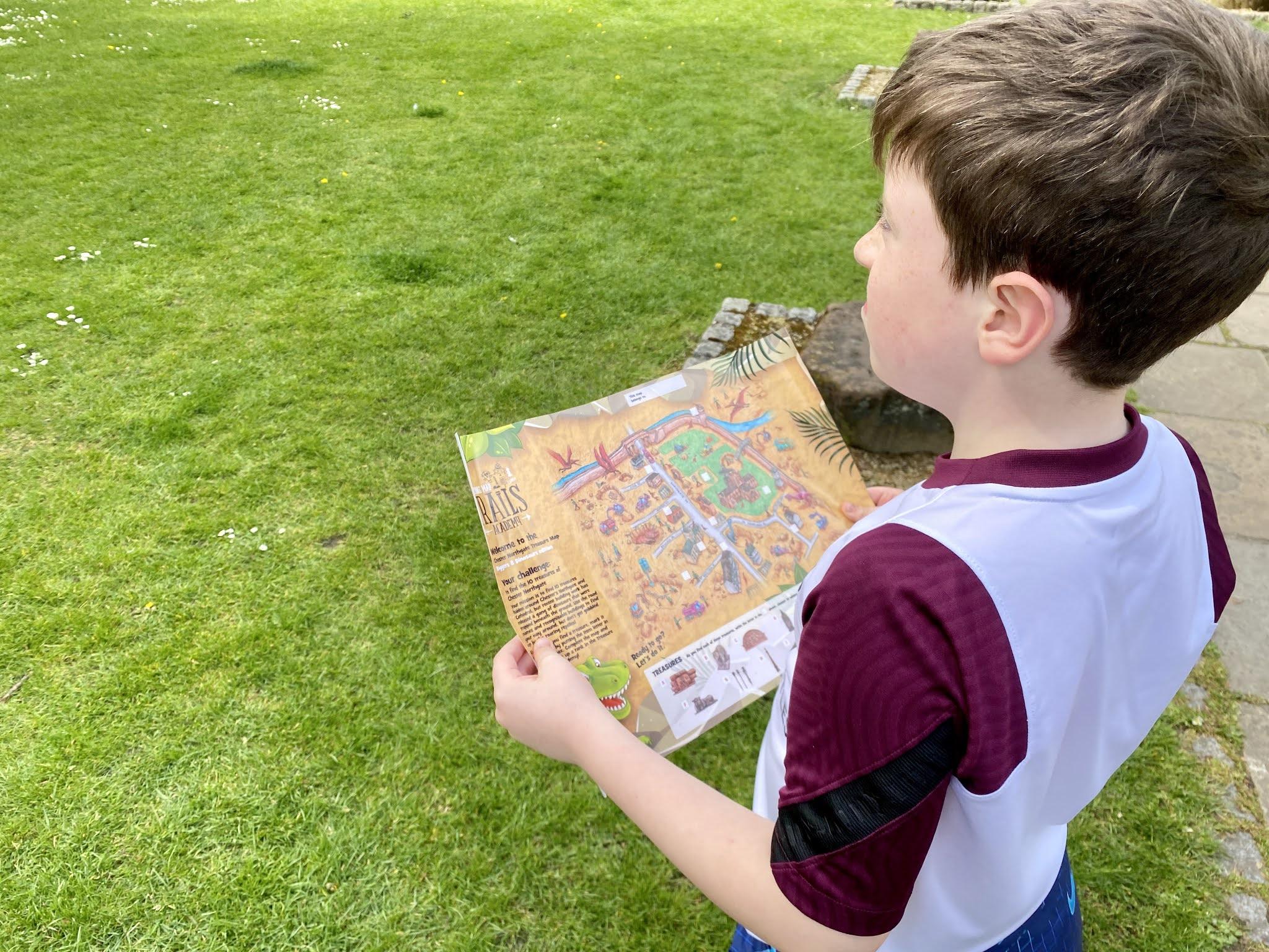 Boy holding a treasure map