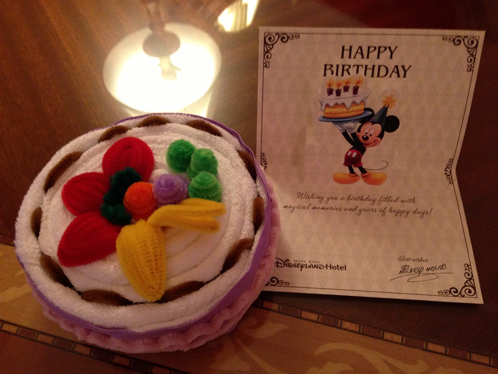 In Our Room We Were Greeted With This Birthday Cake Towel Complete A Card Signed By No Less Than Mickey Mouse Himself